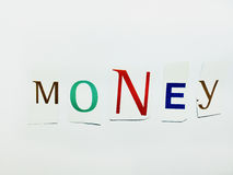 Money - Cutout Words Collage Of Mixed Magazine Letters with White Background. Caption composed with letters torn from magazines with White Background Royalty Free Stock Photo