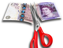Money Cuts UK. Concept illustrating budget cuts with scissors and £20 - Government cuts Stock Images