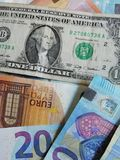 Money. Dólar and euros of 20 and 50 blue and brown colors royalty free stock image
