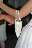 Money Dance. Bride with purse for ceremonial money dance at reception Stock Photography