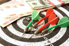 Money darts Stock Images