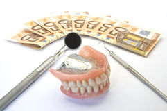 Money and dental prosthesis Royalty Free Stock Photography