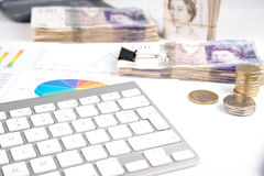 Money  on desk witch chart. British pound sterling bank notes on desk with financial chart Royalty Free Stock Photo