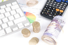 Money on desk witch chart. British pound sterling bank notes on desk with financial chart royalty free stock images