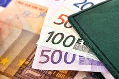 Money and diary Royalty Free Stock Photos