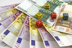 Money and dice. On the white background Stock Photography