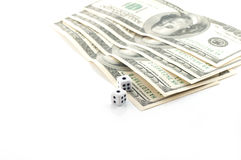 Money and dice Stock Images