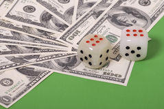 Money and dice. Lot of paper money, dollars, and dice on green Stock Photos