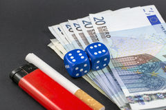 Money, dice and cigarette Royalty Free Stock Photo