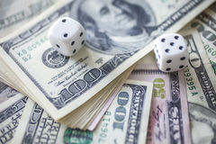 Money, dice for gambling Royalty Free Stock Image