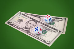 Money with dice on green background. Royalty Free Stock Photos