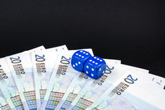 Money and dice Royalty Free Stock Photos