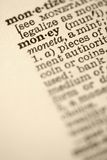 Money in dictionary. Royalty Free Stock Photo