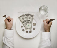 Money diet concept. Man holds fork and knife. Doll Royalty Free Stock Photography