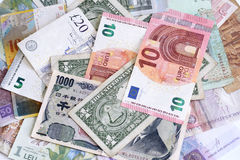 Money from different countries. Closeup Royalty Free Stock Photography