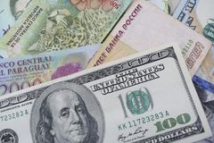 Money from different countries, dollars, Argentine and Paraguayan pesos, Russian rubles. Royalty Free Stock Photography