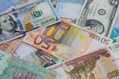 Money from different countries. Dollars, euros, hryvnia, rubles Royalty Free Stock Photo