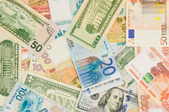 Money from different countries: dollars, euros, hryvnia, rubles. Background Royalty Free Stock Image