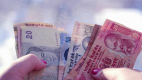 Money in different countries in the hands of a girl, add bills, consider, 4k., 3840x2160 stock footage