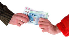 Money for the different purposes. Hand in red and a hand in black, and in the middle - money Royalty Free Stock Image