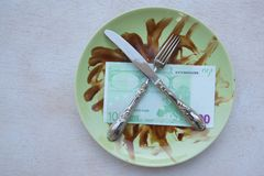 Money on a dirty plate Stock Image