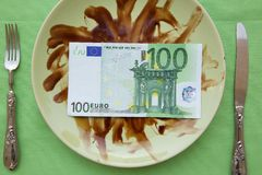 Money on a dirty plate Royalty Free Stock Images