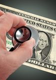 Money Doctor. Doctor verify money disorder by a stethoscope royalty free stock photo