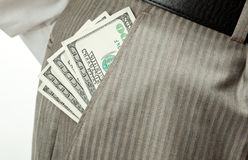 Money (dollar banknotes) in businessman's pocket Royalty Free Stock Image