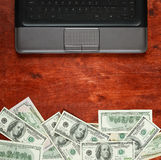Money dollar currency and laptop computer on wood background, business concept, blank space, mock up Stock Images