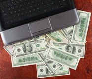 Money dollar currency and notebook computer on wood background, business concept, blank space, mock up Stock Image