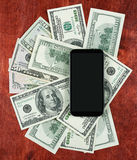 Money dollar currency and smartphone on wood background, business concept, blank space, mock up Royalty Free Stock Photo