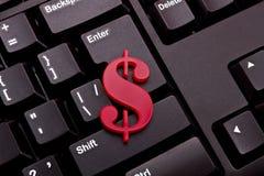 Money. Dollar sign shape made of plexiglas lie on a black computer keyboard background Royalty Free Stock Photo