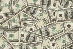 Money dollar wallpaper. Wallpaper of 100 dollar bills randomly placed. high resolution Royalty Free Stock Images