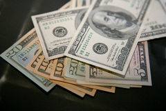 Money (dollars). Images fans dollar bills of different denominations Royalty Free Stock Photos