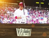 Money dollars against the background of a TV showing baseball, sports betting, money dollars, ball
