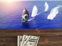 Money dollars on the background of a TV on which show sailing, sports betting, money dollars. Money dollars on the background of a TV on which show sailing royalty free stock image