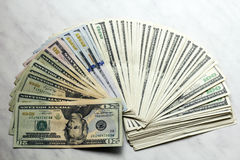 Money dollars banknotes of different denomination. On table Royalty Free Stock Photography