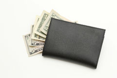 Money dollars in black wallet. Some cash in black wallet background Stock Photo