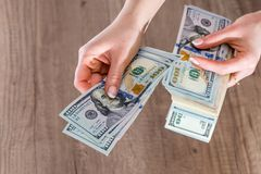 Money dollars in the female hands.  Stock Photo