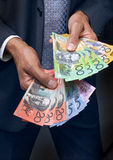 Money Dollars Hands Business. A business man holding a large quantity of Australian money in his hands Stock Image