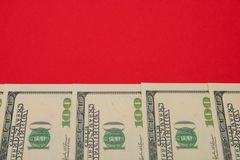 Money, dollars neatly laid out on a red background with a copy of space.  Royalty Free Stock Photography