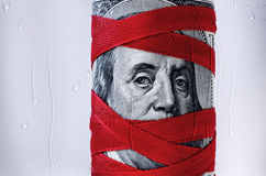 Money_Dollars_Red_Ribbon. Money wrapped with an red ribbon Stock Images