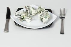 Money dollars wealth millionaire. Money dollars lie on a plate symbolize wealth Stock Photo