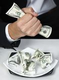 Money dollars wealth millionaire. Money dollars lie on a plate symbolize wealth Stock Image