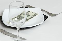Money dollars wealth millionaire. Money dollars lie on a plate symbolize wealth Royalty Free Stock Photography