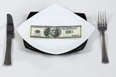 Money dollars wealth millionaire. Money dollars lie on a plate symbolize wealth Royalty Free Stock Images
