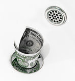 Money down the drain. Throwing money down the drain Stock Photos