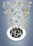 Money Down The Drain Stock Photos