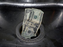 Money down the drain 3. Concept photo of money going down the rain royalty free stock photo