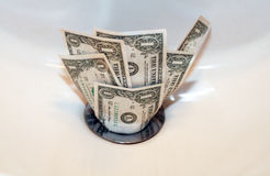 Money down the drain. Dollar bills going down the drain Royalty Free Stock Photos